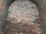 Zamurowane wejście od strony Koszar